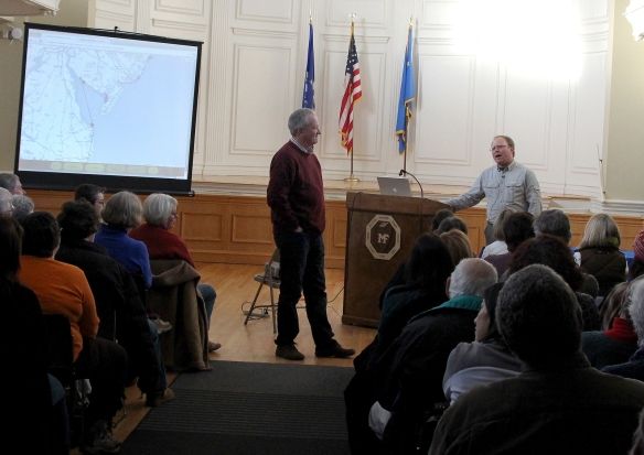 Photo by Chris Bosak CT Audubon Director of Conservation Science Milan Bull, left, moderates a Q&A session with Don Crockett, right during a Snowy Owl presentation at Milford City Hall on Sunday, Jan. 25, 2015.