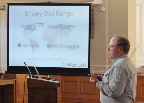Photo by Chris Bosak Don Crockett of Project SNOWStorm talks about Snowy Owls during a presentation at Milford City Hall on Sunday, Jan. 25, 2015.