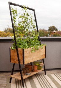 Gardener's Supply Company Planter boxes with built-in trellises like this Apex trellis planter enable gardeners to maximize their garden space for growing vegetables and flowers.