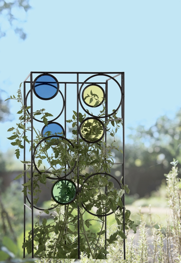 Gardener's Supply Company The Kaleidoscope Tomato Cage provides a sturdy support for tomato plants while adding color to the landscape