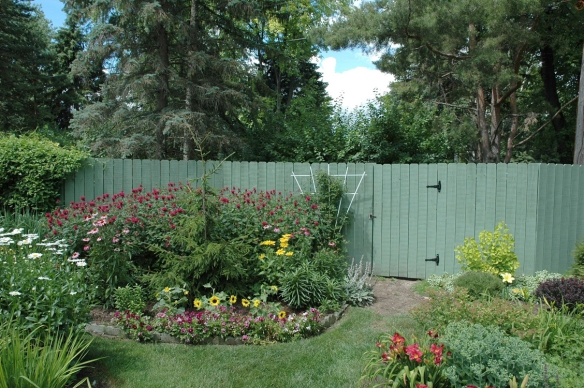 By Melinda Myers, LLC Decorative fences are an effective way to hide composting stations conveniently tucked behind gardens in the landscape.