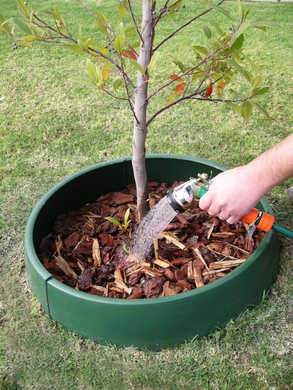 The GreenWell water saver contains and concentrates the water where it is needed during a tree's critical root establishment phase.